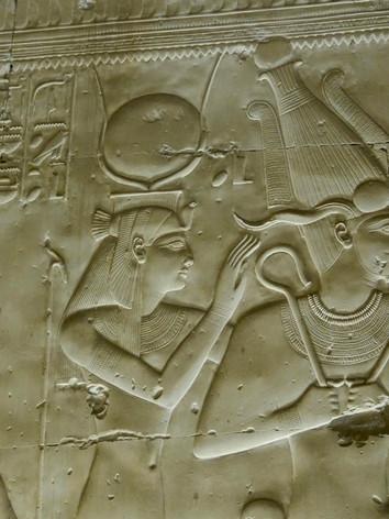 Osiris, Isis and Horus look towards Seti I while ...