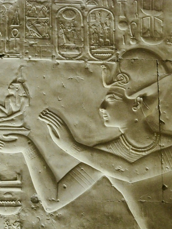 ...Seti I offers Maát (harmony, order) to Osiris, Isis and Horus, from the Seti I temple