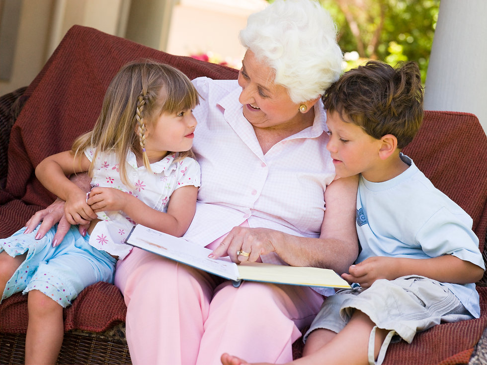 grandmother-reading-a-book-to-grandchild