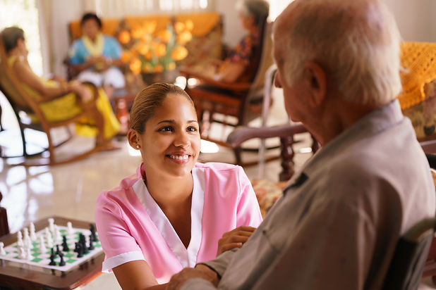 graphicstock-old-people-in-geriatric-hospice-young-attractive-hispanic-woman-working-as-nu