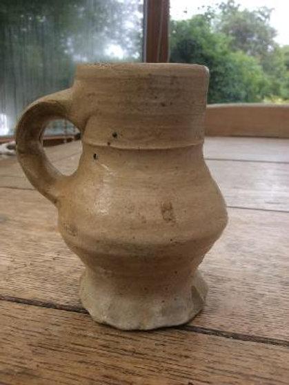 Thumbed base stoneware tudor crug c1550