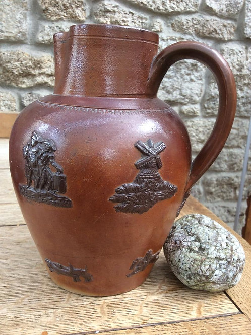 Scottish brown sprigged stoneware hunting jug c1850