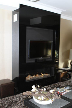 Fireplace / TV with black glass