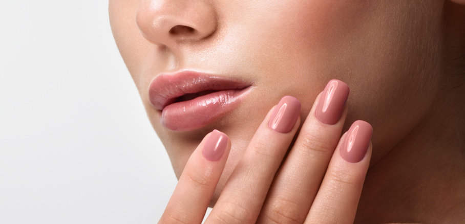 Close Up Woman lips and nails in dusty rose