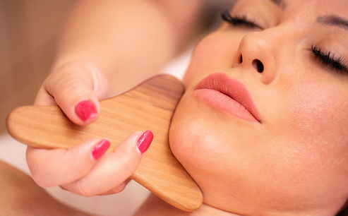 Facial madero massage of a neck and chin area with natural fragrant wood massager_edited.j