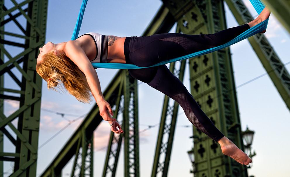 photo of air yoga on a bridge
