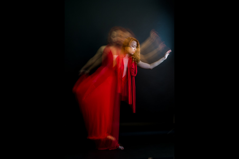 long exposure photo of a woman in dress