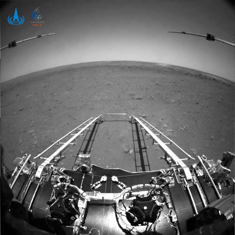 In this black and white photo taken by China's Zhurong Mars rover and made available by the China National Space Administration (CNSA) on Wednesday, May 19, 2021, extension arms and a departure ramp are deployed on the rover's lander on the surface of Mars. China landed a spacecraft on Mars for the first time on Saturday, a technically challenging feat more difficult than a moon landing, in the latest step forward for its ambitious goals in space. Credit: CNSA via AP