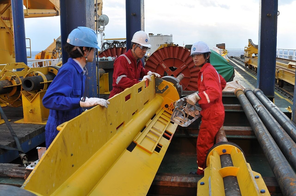 Drill preparation. The team prepare the deep-sea drill for use on the seafloor. Credit: JAMSTEC-IODP