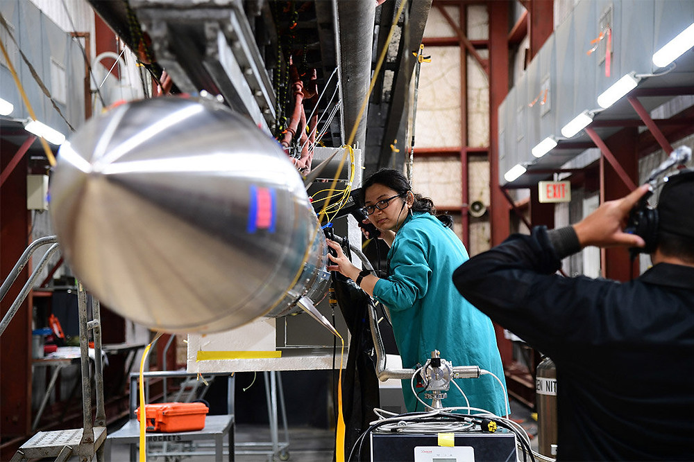 Chi Nguyen '21 Ph.D. (astrophysical sciences and technology) makes final adjustments to the rocket payload prior to CIBER-2's launch. Credit: NSROC III/NASA