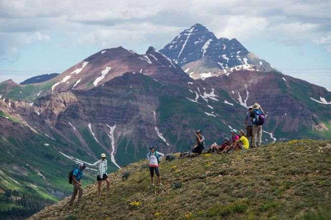 Group of hikers on top of mountain in Colorado.