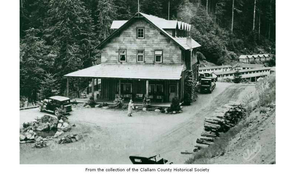 Photo of historic log resort in the forest
