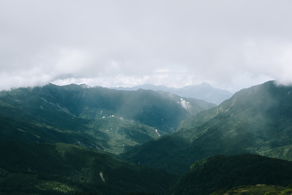 Green mountains and stormy clouds.