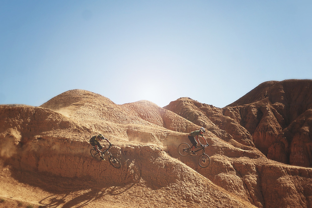 Two mountain bikers in the desert.