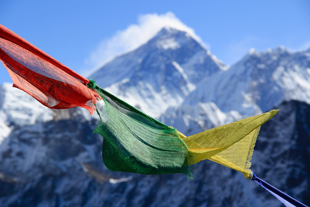 Nepalese flags in front of mountain