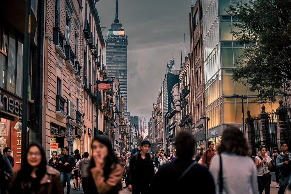People walking in busy city street