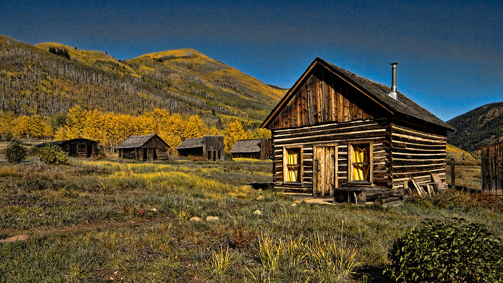 Old log building during fall in Colorado.