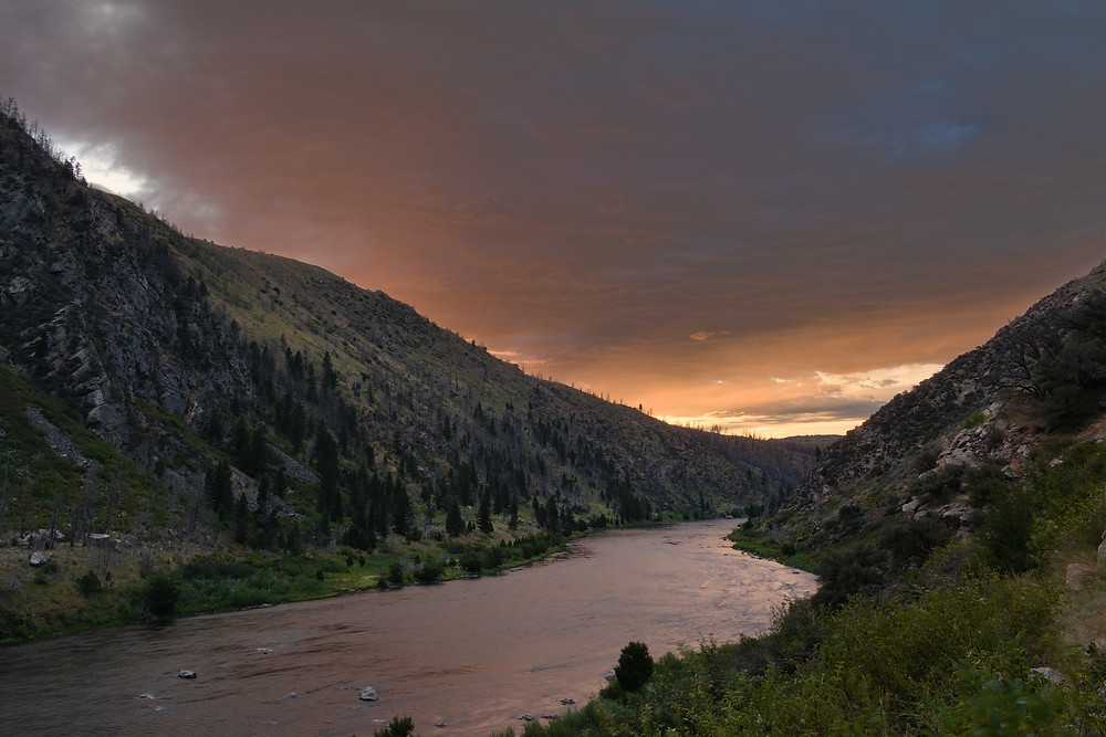 Sunset over river in mountains of Montana