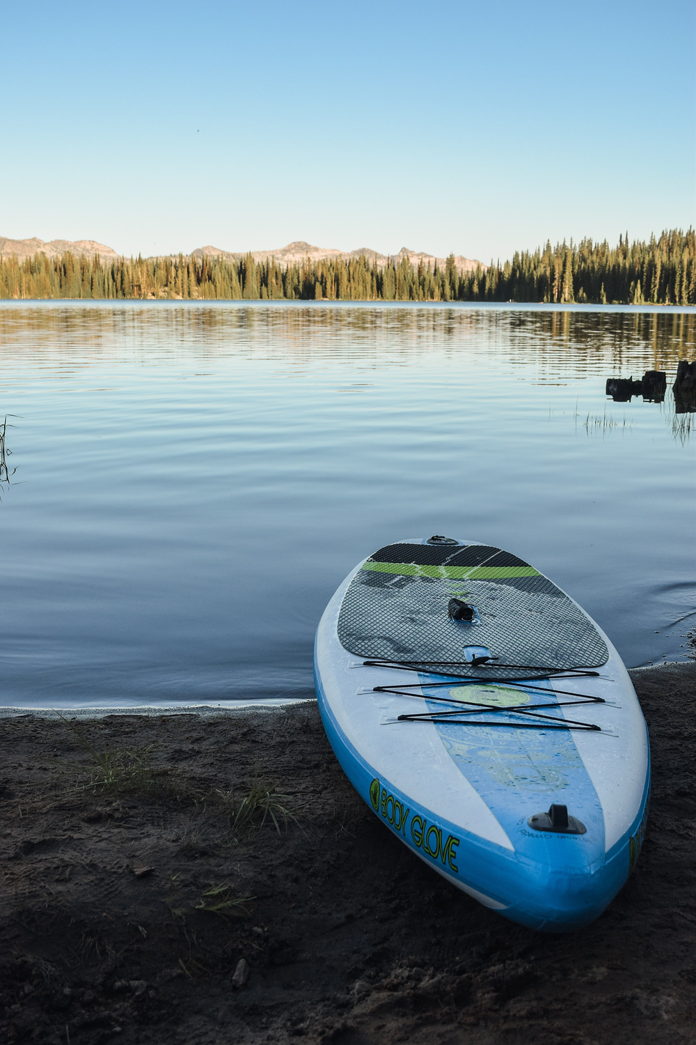 Paddleboard in front of mountain lake