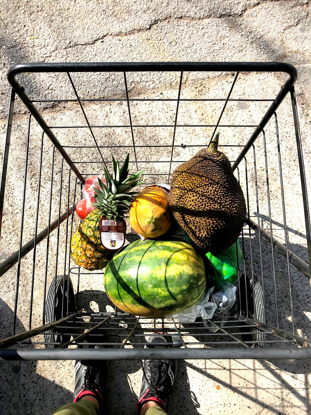 Cart with fruits in it.