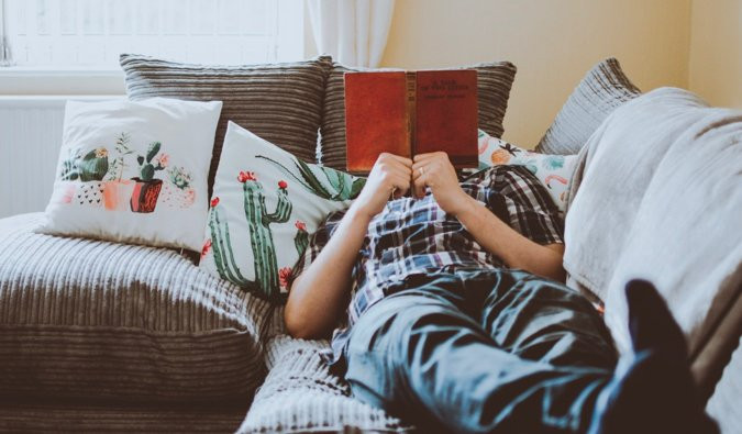 Person reading on couch