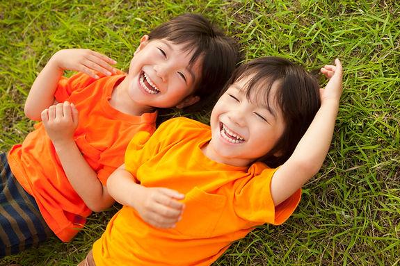 Singaporean children laugh happily