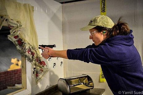 Woman Shooting in a gun match IDPA