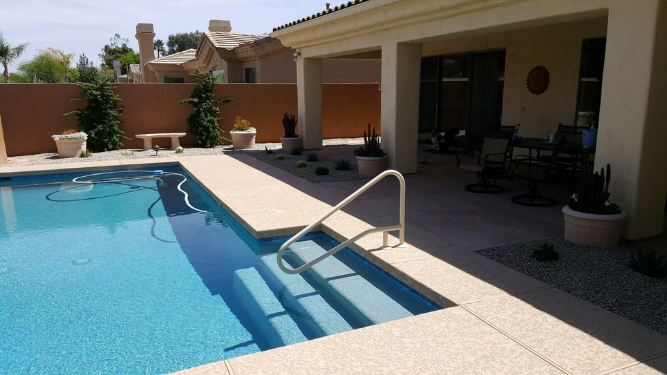 Swimming Pool Remodel in Scottsdale with New Aqua Blue Pebble Sheen, Tile and Handrail
