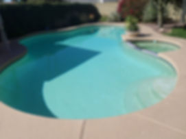 Old Plaster Pool needs plaster resurface. By removing the spa we converted into a Sun Shelf in Scottsdale Arizona. We provide pool resurfacing and pool remodeling.