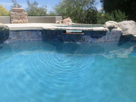 Pool Remodel in Rio Verde with Capped Flagstone Spillway with a Bobe Copper Custom Spillway