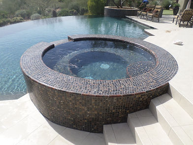 Swimming Pool Service & Repair in Phoenix installs all tile in spas and pools in a pool remodel.