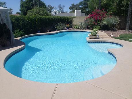 Remove Spa and Add Sun Shelf with Blue Saphire Ultra Poz upgraded Quartz Plaster for Resurface in Scottsdale Arizona.