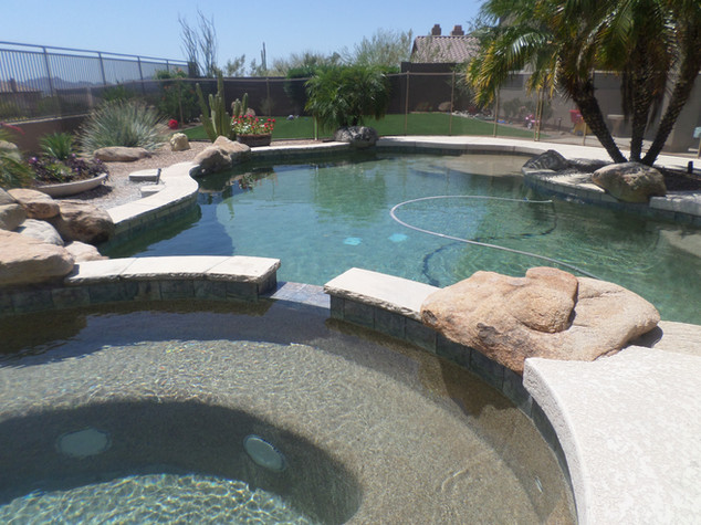 Swimming Pool Remodel in Mcdowell Mountain with Flagstone Conversion and Tile Addition