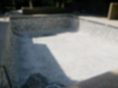 Chipped Out Empty White Plaster Pool in Scottsdale. We got this pool ready or pool plaster resurface with pebble sheen and pebble tec.