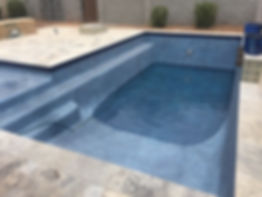 Pebble Tec pool filling up after the pool resurface was replastered. Expert Pool Contractors at work.