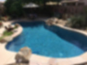 This Pebble Sheen Pool Blue Surf is a beautiful color. We resurfaced this old plaster pool and installed flagstone to cracked pebble tec beam. Baja Shelf and Rock water feature in Arizona.