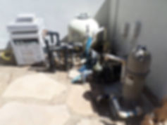 Old pool equipment that requires pool and spa pump and filter repairs.