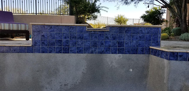 This is after we performed a calcium clean on waterline tile and spillway a pool. We seal the tile and perform many pebble patch procedures in Scottsdale, AZ all the time. We are known for pool repairs.