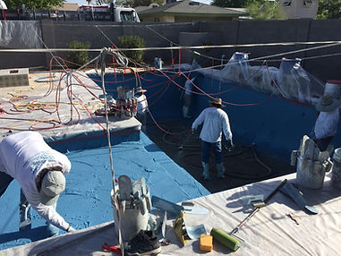 Cal Plastering division applying Pebble Sheen to pool. This is the Pool Replastering stage.