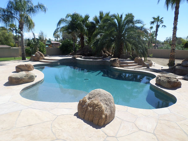 Swimming Pool Service and Repair did a remodel of this Pebble Tec Pool. The replastering process requires curing and perfect pool chemistry. Pool care is very important to your pool surface. We are experts in pool remodeling in Phoenix, Scottsdale, Mesa and Glendale Arizona.