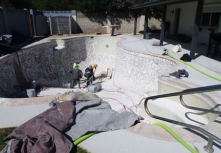 Demo crew chipping out a white plaster swimming pool to prep for pebble sheen in scottsdale. This pool resuface was quickly done.