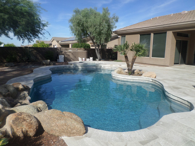 Free Form Pool Remodel with Blue Surf and Boulevard Light Limestone