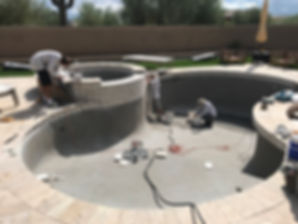 Swimming Pool Service & Repair installing new pool tile to existing Pebble Sheen Pool in Scottsdale. We add tile to old pools.