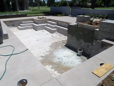 Pool Chipped out with waterfeature addiion. Ready to add pool tile and pebble sheen in glendale, az. Pool remodeling from here to phoenix.