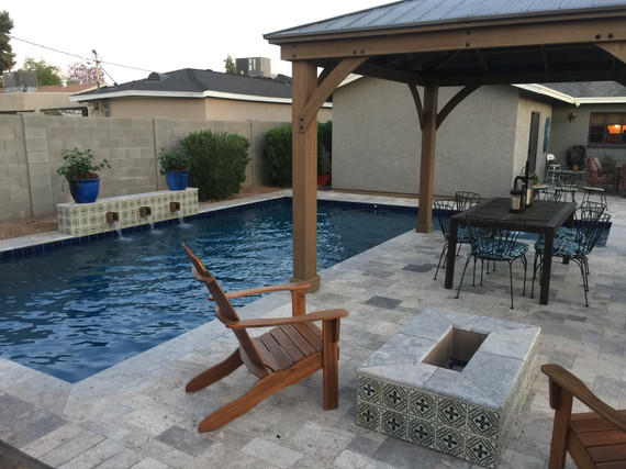 Swimming Pool with Gazebo, Raised Water Feature, Fire Pit and Silver Travertine