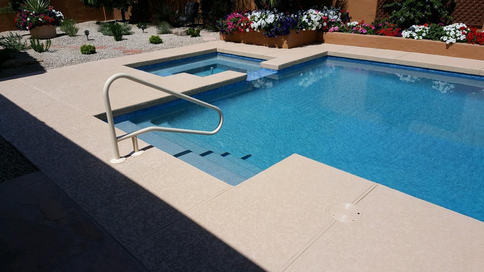 Swimming Pool Remodel with Aqua Blue Pebble Sheen, Saftron Handrail and Aqua Blue Waterline Tile
