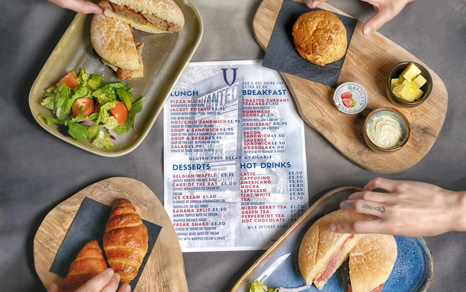 Food menu with hands villain bar.jpeg