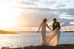 Bryllupsbilder i solnedgang