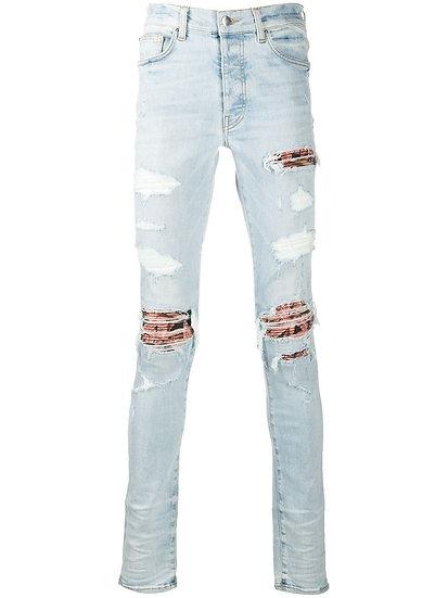 AMIRI MX1 Distressed Skinny Jeans