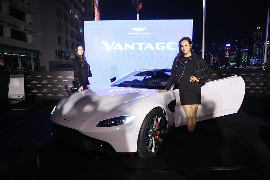 White Aston Martin Vantage Event with 2 models wearing black in Hong Kong